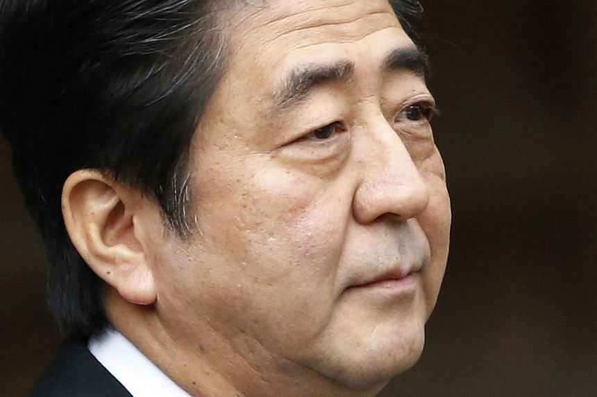 Japan's Prime Minister Shinzo Abe leaves the controversial Yasukuni Shrine after paying tribute to the war dead, in Tokyo on Dec 26, 2013. -- PHOTO: REUTERS