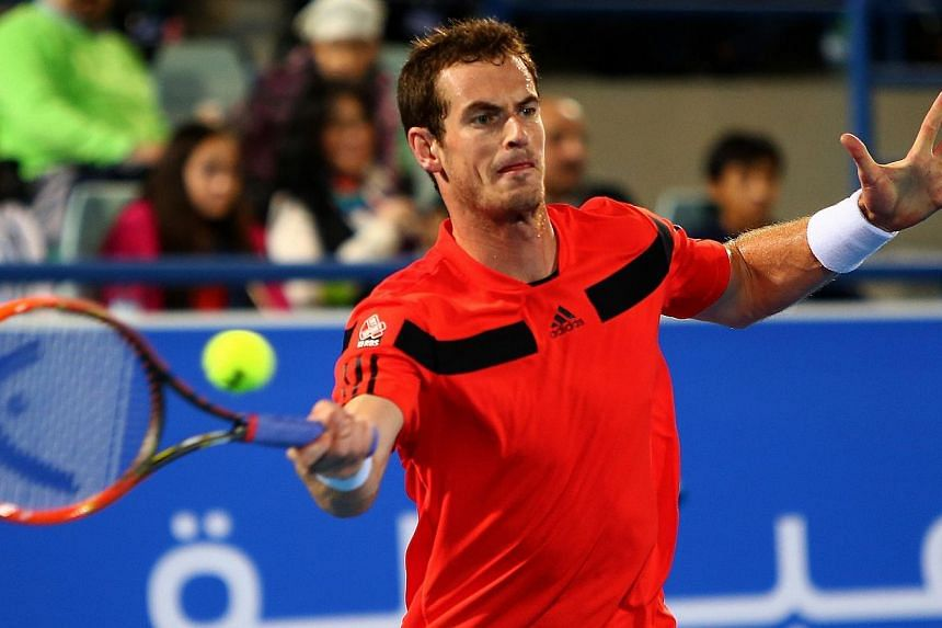 Andy Murray of Great Britain returns the ball to France's Jo-Wilfried Tsonga during their Mubadala World Tennis Championship match in the Emirati capital Abu Dhabi on Dec 26, 2013. Murray's return to action after a three-month injury lay-off ended in