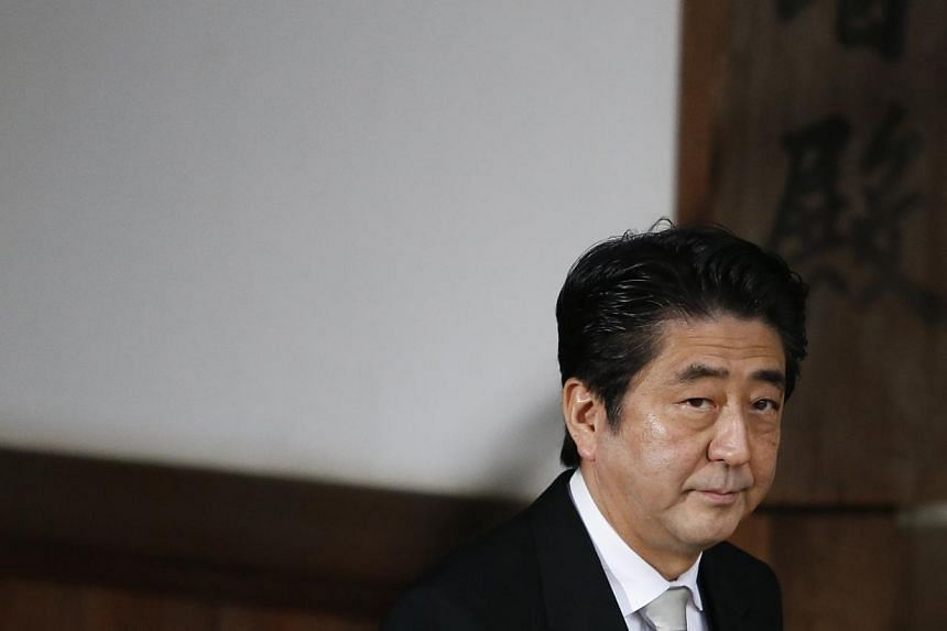 Japan's Prime Minister Shinzo Abe leaves at controversial Yasukuni Shrine after paying tribute to the war dead, in Tokyo on December 26. -- PHOTO: REUTERS