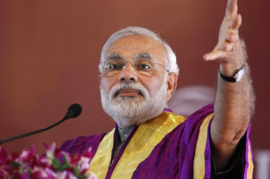 Gujarat's chief minister and Hindu nationalist Narendra Modi, the prime ministerial candidate for India's main opposition Bharatiya Janata Party (BJP) speaks during a convocation ceremony at Pandit Deendayal Petroleum University (PDPU) earlier this y