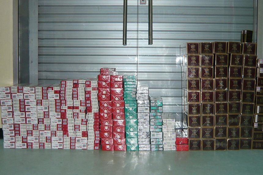 In the first nine months of this year, the Singapore Customs seized 1.9 million packets of duty-unpaid cigarettes, a rise of 84 per cent. -- PHOTO: SINGAPORE CUSTOMS