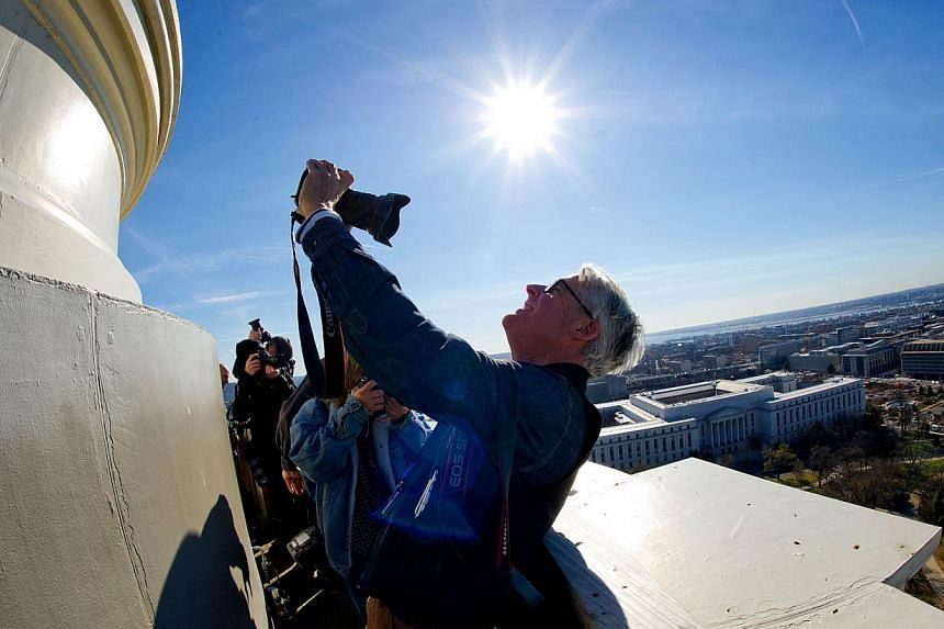 A photographer takes a selfie from the top of the US Capitol dome during a tour of the dome on Dec 19, 2013, in Washington, DC. Self-portraiture has been around for centuries, but the global proliferation of smartphones with built-in digital cameras