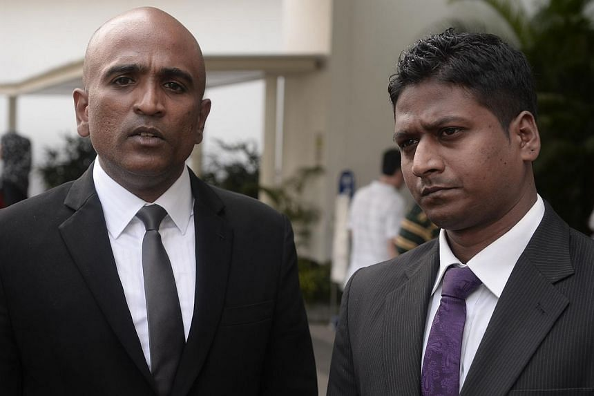 Arun Kaliamurthy, who has posted bail, speaks to the press with his lawyer M. Ravi (left), before leaving The Subordinate Courts on Dec 27 , 2013.-- ST PHOTO:MARK CHEONG