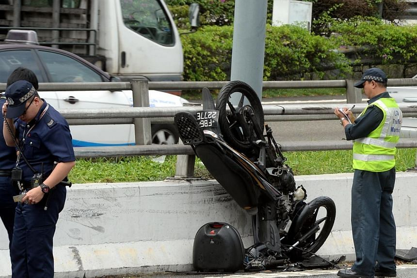 A 23-year-old man was injured after his motorcycle collided into a van in front of him. -- ST PHOTO:AZIZ HUSSIN
