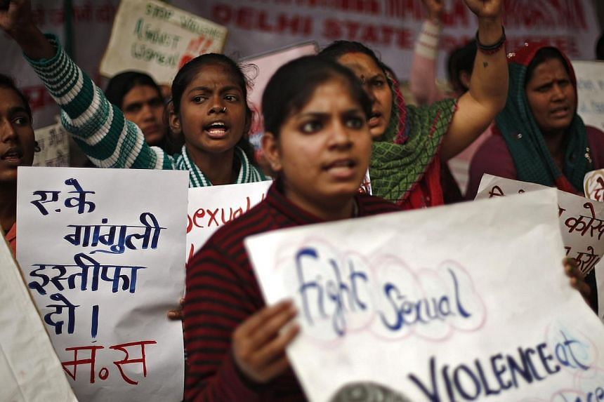 Protesters hold placards as they shout slogans during a protest to mark the first anniversary of the Delhi gang rape, in New Delhi Dec 16, 2013.A 20-year-old woman was allegedly gang-raped on Christmas Eve in south India, media reports said on