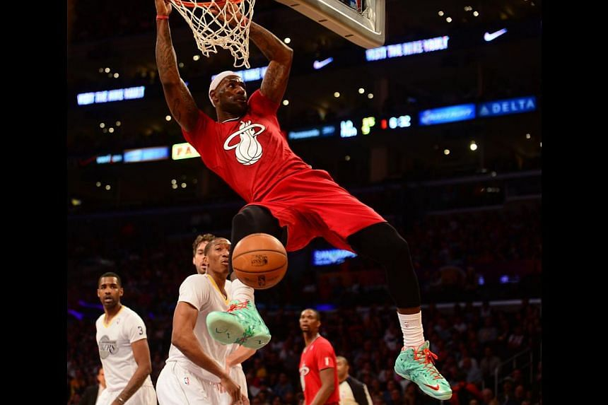 LeBron James of the Miami Heat scores against the Los Angeles Lakers during their Christmas Day NBA matchup at Staples Center in Los Angeles, California on Dec 25, 2013.Four-time NBA Most Valuable Player LeBron James and NBA scoring leader Kevi