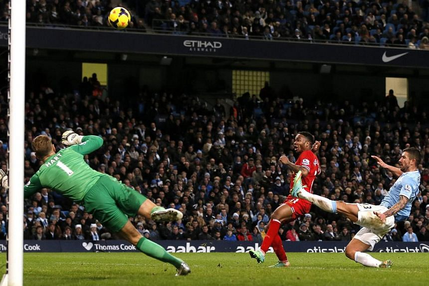 Liverpool's Raheem Sterling shoots wide of the goal during their English Premier League soccer match against Manchester City at the Etihad stadium in Manchester, northern England on Dec 26, 2013.Negredo's ninth goal in nine home games saw Manch