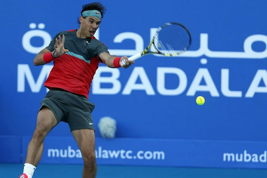Rafael Nadal of Spain hits a return to compatriot David Ferrer during their semi-final tennis match at the Mubadala World Tennis Championship in Abu Dhabi, on Dec 27, 2013. Nadal got his season under way with a 4-6, 4-6 loss to fellow Spaniard David