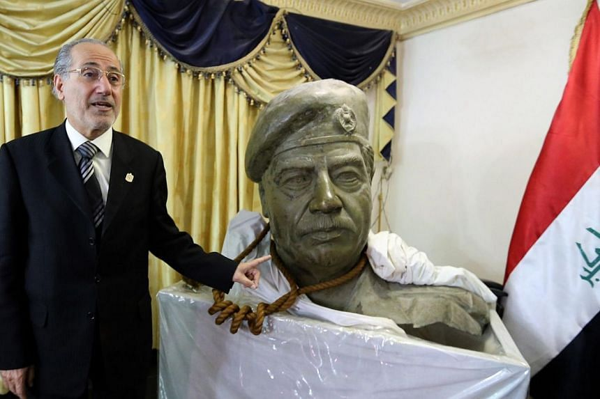 The bust of former Iraqi leader Saddam Hussein and the actual rope used to hang him, are on display in the living room of former national security adviser Mowaffak al-Rubaie, seen during an interview with the AFP where he gave details of his executio