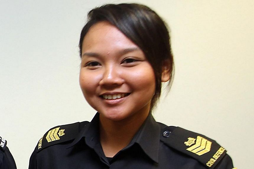 Staff Sgt Nor Aisyah (above) is among the personnel whose experiences have been compiled into a special report by the SCDF. -- ST PHOTO: LAU FOOK KONG