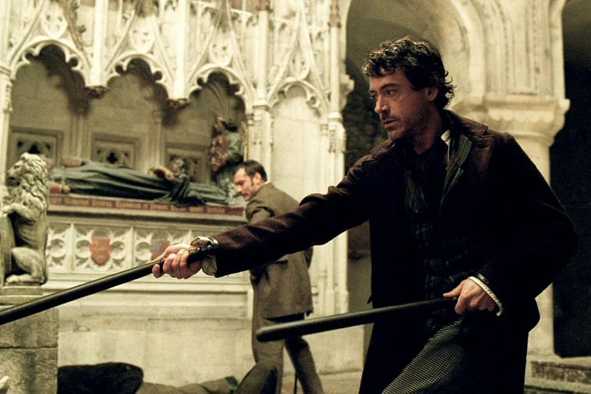 Cinema still from Sherlock Holmes starring Robert Downey Jr (front) and Jude Law. -- FILE PHOTO: GOLDEN VILLAGE PICTURES