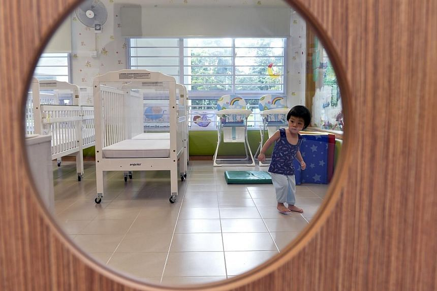 Twenty-month-old Frederick Toh exploring the new Nap Room during the opening of aPAP Community Foundation Sparkletots infant- and child-care centre at Senja Road in Bukit Panjangon Saturday, Dec 28, 2013.-- ST PHOTO:DESMOND FO