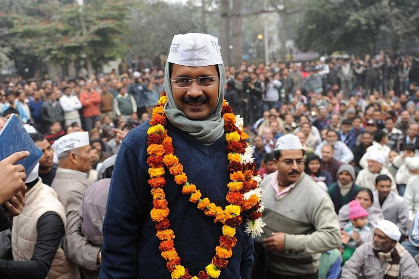 India's Aam Aadmi Party leader Arvind Kejriwal is greeted by supporters as he arrives at a public meeting in New Delhi on Dec 22, 2013.Anti-corruption champion Arvind Kejriwal was sworn in on Saturday as chief minister of India's national capit