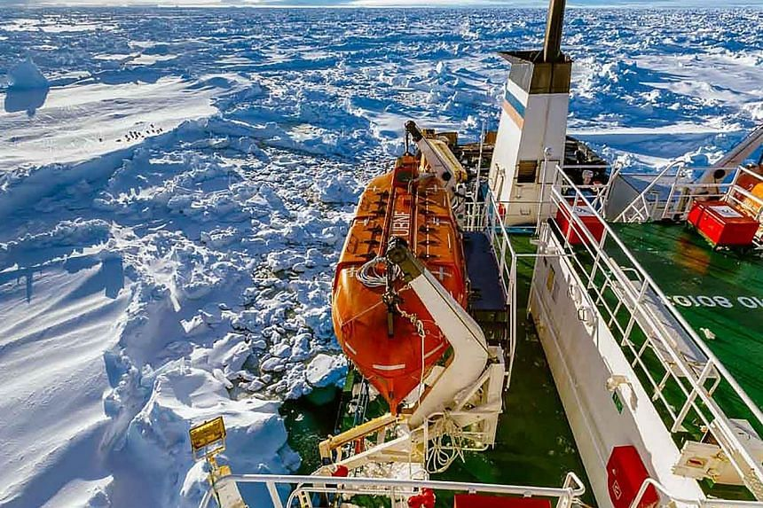 The ship MV Akademik Shokalskiy trapped in the ice at sea off Antarctica, on Dec 27, 2013. -- PHOTO: AFP/FOOTLOOSEFOTOGRAPHY.COM