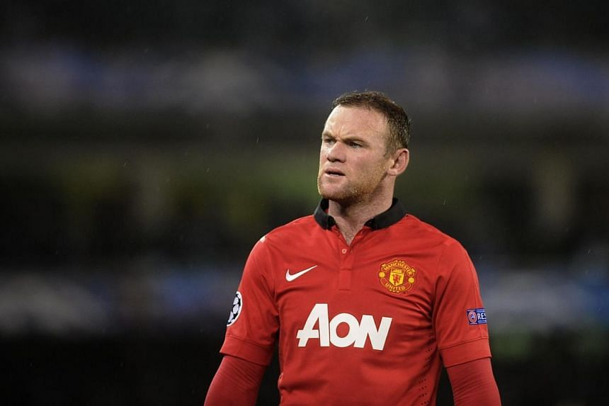 Wayne Rooney was a surprise absentee from Manchester United's squad for their Premier League clash against Norwich on Saturday, Dec 28, 2013. -- FILE PHOTO: AFP