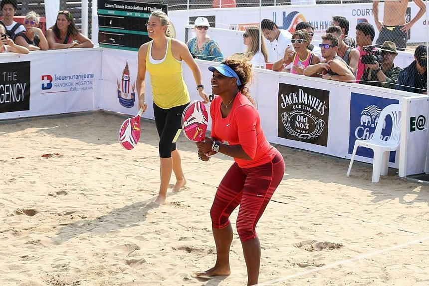 Serena Williams (right) of the US and Victoria Azarenka of Belarus play beach tennis while opening Hua Hin Beach Tennis Championship 2013, in Prachuap Khiri Khan province, Thailand, on Dec 28, 2013.World number two Victoria Azarenka battled bac