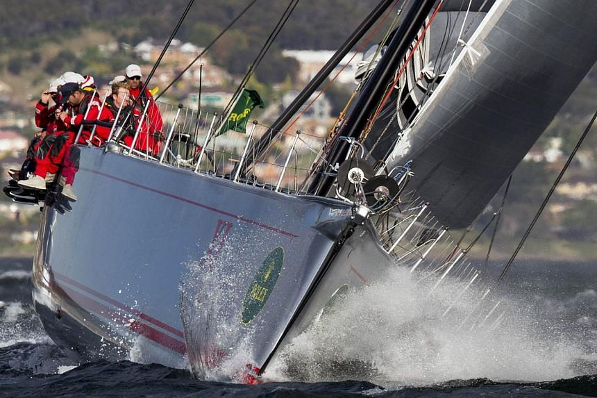 Wild Oats XI winning the race on Dec 28, 2013. Wild Oats XI secured a record-equalling seventh victory in the Sydney to Hobart ocean classic when it sailed down the Derwent River well clear of its nearest rival on Saturday, Dec 28, 2013, evening. --
