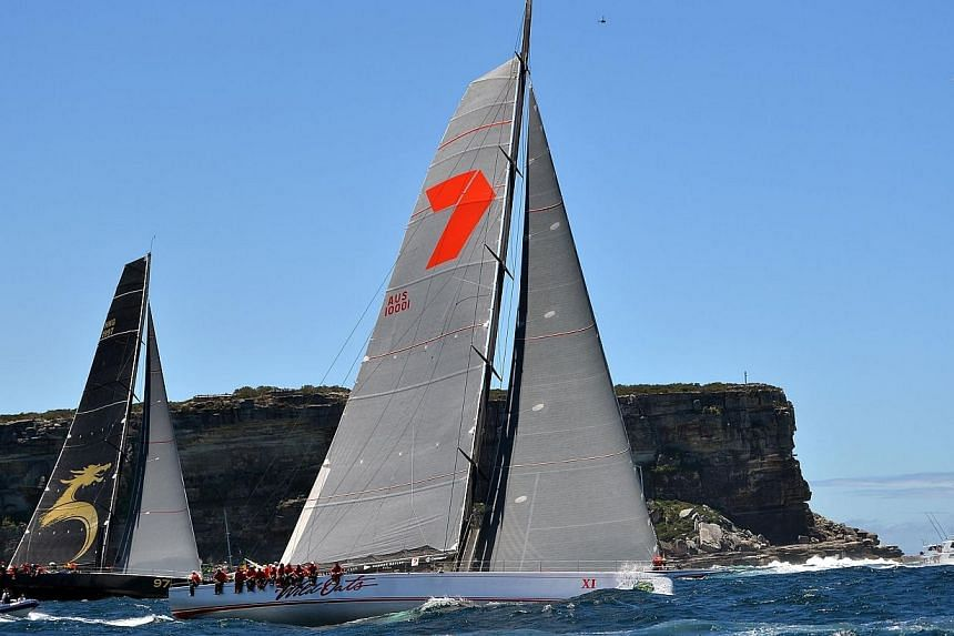Wild Oats Xl (right) and Beau Geste sails out of the Heads at the start of an annual Sydney to Hobart yacht race, on Dec 26, 2013. -- FILE PHOTO: AFP/REGATTANEWS.COM
