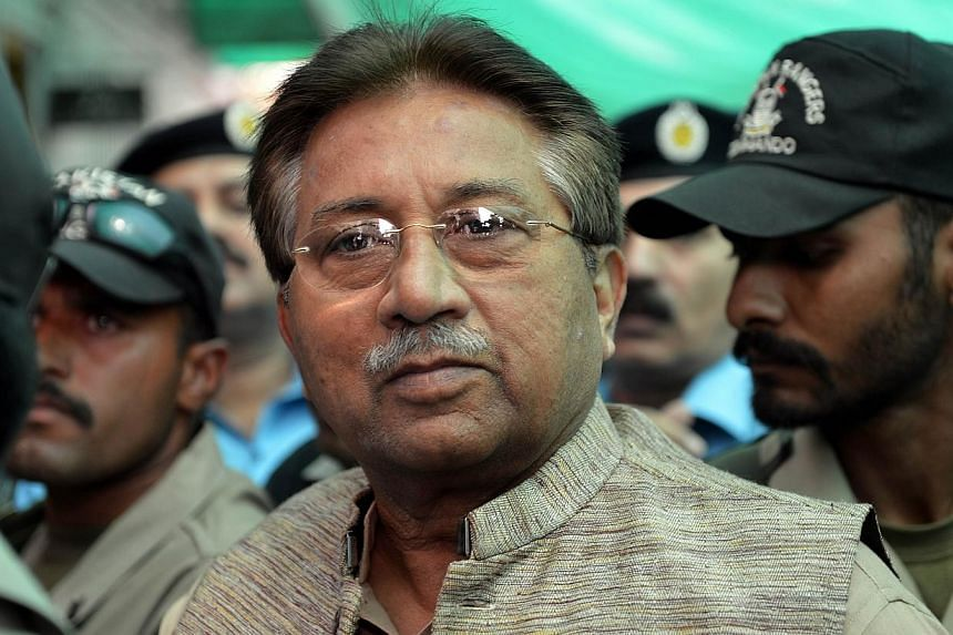 Former Pakistani president Pervez Musharraf (centre) is escorted by soldiers as he arrives at an anti-terrorism court in Islamabad, on Apr 20, 2013. Pakistan's former military ruler Pervez Musharraf on Sunday denounced treason charges against him as