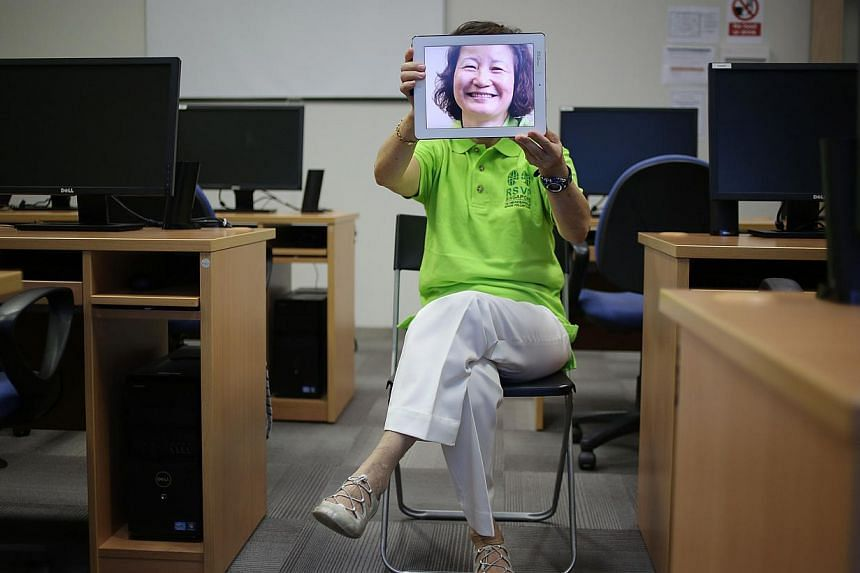 Madam Cheow Chin Wang, 63, uses an Acer laptop, iPhone 4 and iPad 2 to check her e-mail and surf the Web. She is among a growing group of older users of mobile devices who are increasingly technology literate.