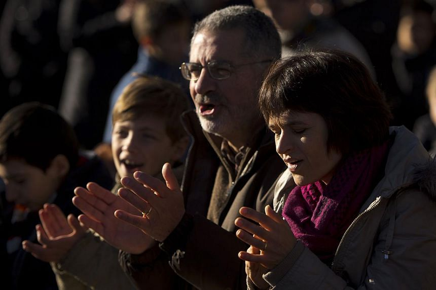 People attend the mass for the Holy Family in Madrid on Sunday, Dec 29, 2013.Tens of thousands of believers poured into central Madrid to celebrate an open-air Roman Catholic mass for the Holy Family on Sunday, just days after the Spanish gover