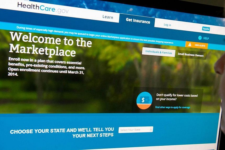 This Dec 2, 2013, photo, shows a woman reading the HealthCare.gov insurance marketplace internet site in Washington, DC.The White House is coming under pressure from some of its closest allies on health-care reform to name a chief executive to