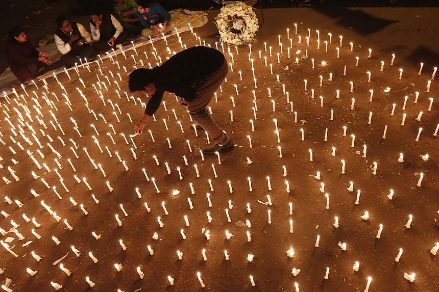 A protester lights candles during a candlelight vigil to mark the first anniversary of the Delhi gang rape, in New Delhi on Dec 16, 2013. India on Sunday marks 12 months since the death of a student savagely gang-raped on a Delhi bus - an episode tha