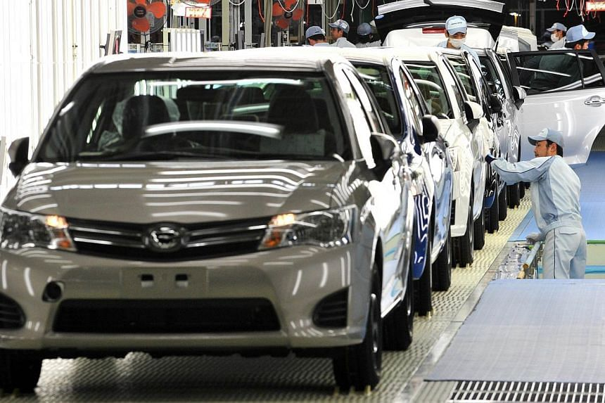 Workers check paints and bodies of the new model of Toyota Motor's best selling car Corolla at a plant of the company's subsidiary Central Motor at Ohira village in Miyagi prefecture, northern Japan on on May 11, 2012. Japanese automakers will ramp u