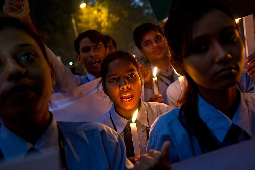 Indian students take part in a candle-light vigil commemorating the December 2012 fatal gang-rape of an Indian woman, in New Delhi on Dec 16, 2013. -- FILE PHOTO: AFP