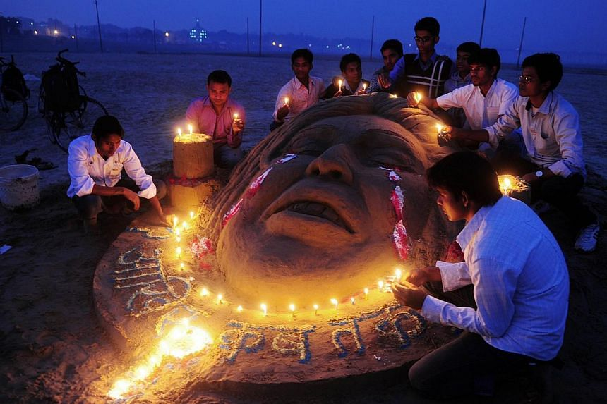 Indian students make a sand sculpture to pay homage as they commemorate the first anniversary of the fatal gang rape of the 23-year-old New Delhi student on a moving bus, in Allahabad on Dec 16, 2013. -- FILE PHOTO: AFP