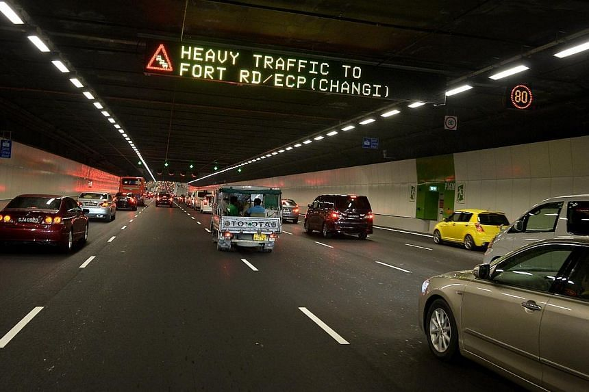 A sign warning of congestion after entrance to the MCE from Central Boulevard at about 6.30pm Eastbound towards ECP.Evening traffic on the new Marina Coastal Expressway (MCE) appeared smooth in both directions at 6.30pm on Monday, the first wor