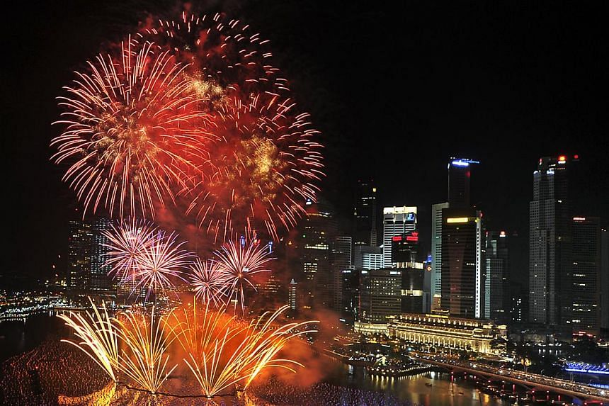 Fireworks light up the sky over Marina Bay on Jan 1, 2011, to welcome the new year. Police, auxiliary police and security officers will be deployed for crowd and traffic control duties at the Marina Bay Singapore Countdown 2014. -- ST FILE PHOTO
