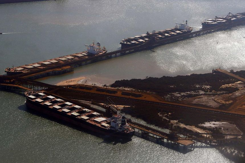 Ships waiting to be loaded with iron ore are seen at Port Hedland in the Pilbara region of Western Australia on Dec 3, 2013. A powerful cyclone packing expected winds of more than 200 kilometres an hour was threatening Australia's west coast on