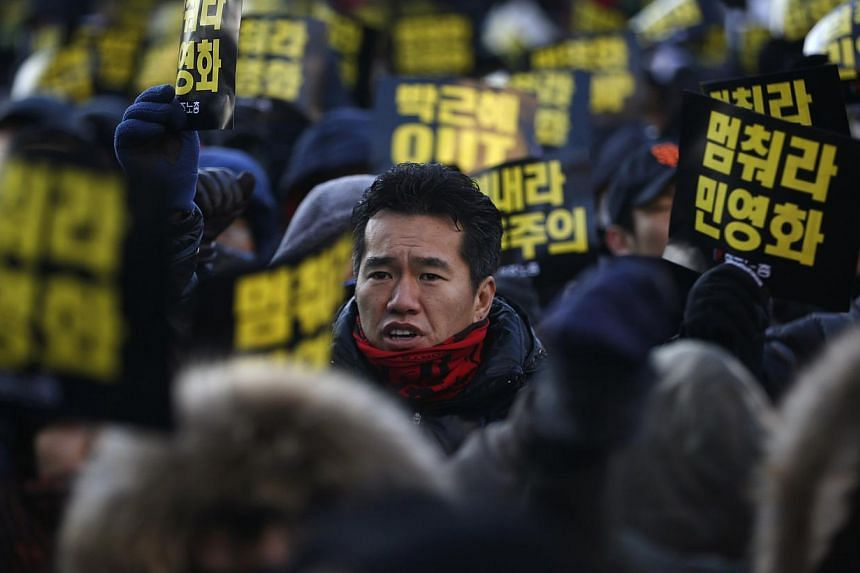 A South Korean worker chants slogans during a general strike in front of Seoul City Hall Plaza in Seoul on Saturday, Dec 28, 2013.Thousands of South Korean railway workers agreed on Monday, Dec 30, 2013, to end a three-week partial strike after