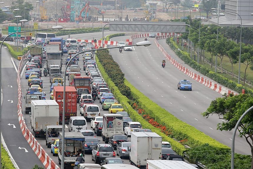 Heavy traffic and traffic jam along the Marina Coastal Expressway photographed on Monday, Dec 30, 2013, in the late morning to noon. -- ST PHOTO: ONG WEE JIN