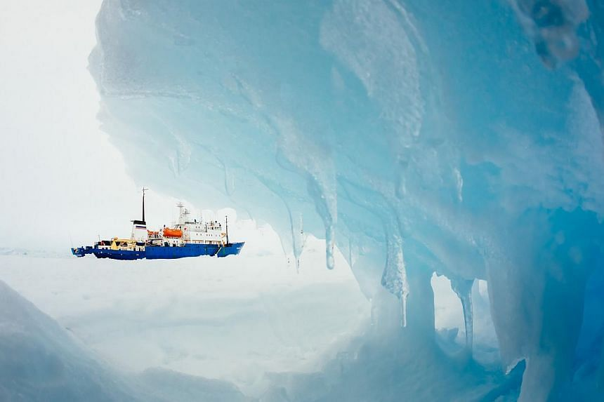 This image taken by passenger Andrew Peacock of www.footloosefotography.comon Dec 30, 2013 shows the ship MV Akademik Shokalskiy still stuck in the ice off East Antarctica, as it waits to be rescued. An Antarctic blizzard has halted an Australian ice