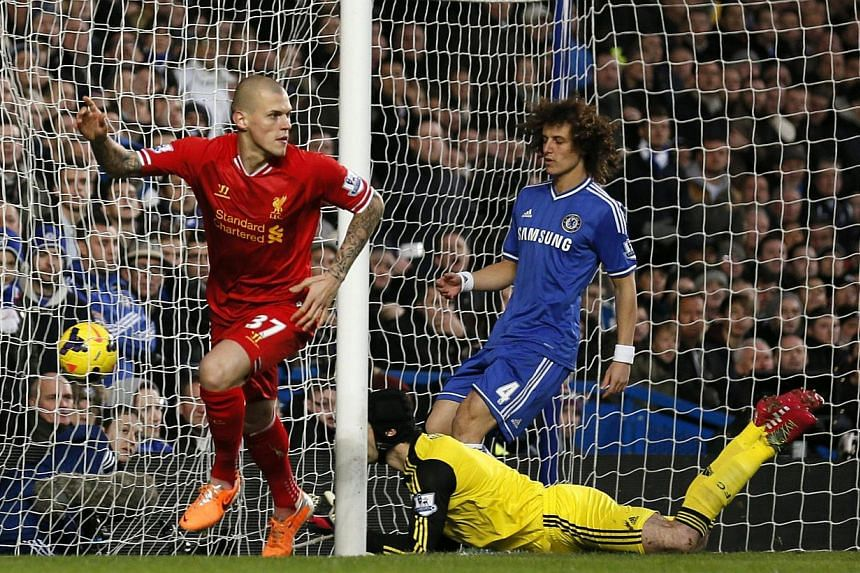 Liverpool's Martin Skrtel (left) scores a goal against Chelsea during their English Premier League soccer match at Stamford Bridge in London on Dec 29, 2013. -- PHOTO: REUTERS