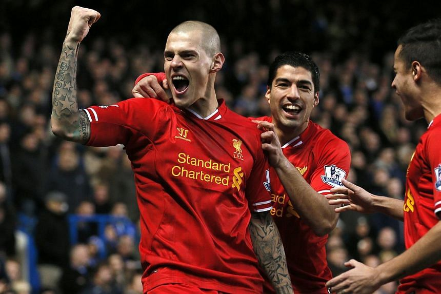 Liverpool's Martin Skrtel (left) celebrates with team mates after scoring a goal against Chelsea during their English Premier League soccer match at Stamford Bridge in London on Dec 29, 2013. -- PHOTO: REUTERS