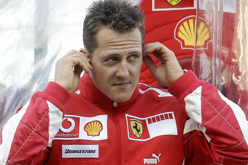 In this photo taken on Feb 2, 2006, German Ferrari Formula one driver Michael Schumacher is seen in the pits during a training session at the Ricardo Tormo racetrack in Cheste near Valencia. -- FILE PHOTO: AFP