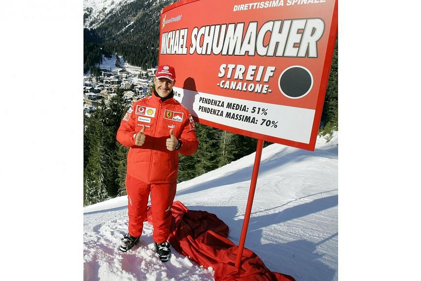 """Photo taken on Jan 12, 2006, shows German Formula 1 world champion Michael Schumacher as he poses during the """"16 WROOOM F1 press meeting """". -- FILE PHOTO: AFP"""