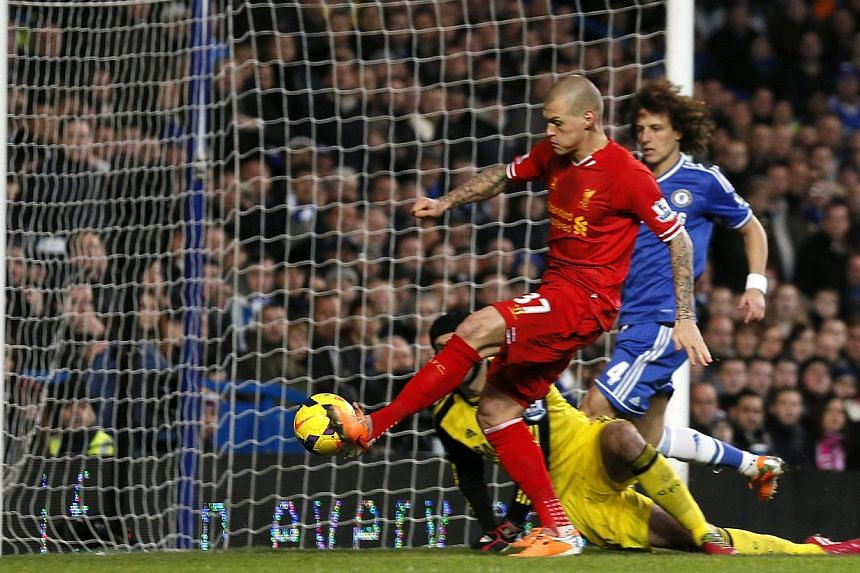 Liverpool's Martin Skrtel (centre) scores a goal against Chelsea during their English Premier League soccer match at Stamford Bridge in London, on Dec 29, 2013. But Chelsea demonstrated their Premier League championship credentials by coming from beh