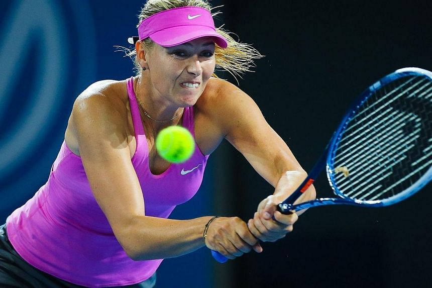 Tennis player Maria Sharapova of Russia hits a forehand during her first round match against Caroline Garcia of France at the Brisbane International tennis tournament at the Patrick Rafter Arena, Brisbane, on Dec 30, 2013. Sharapova returned after fo
