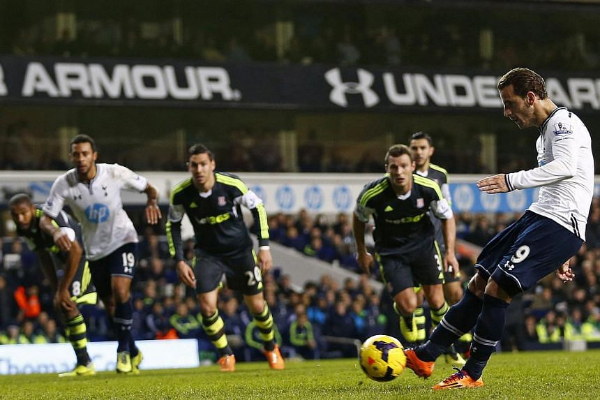 Tottenham Hotspur's Roberto Soldado (right) shoots and scores a penalty against Stoke City during their English Premier League soccer match at White Hart Lane in London, on Dec 29, 2013. -- PHOTO: REUTERS