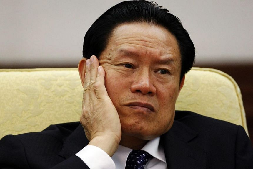 Then China's Public Security Minister Zhou Yongkang reacts as he attends the Hebei delegation discussion sessions at the 17th National Congress of the Communist Party of China at the Great Hall of the People, in Beijing in this Oct 16, 2007 file phot