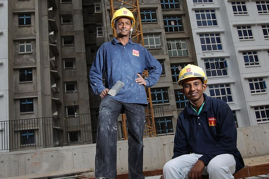 Mr Chaminda Senarath Wijerathna and Mr Pushpa Niroshana Fernando are two of about 30 Sri Lankans hired by Fonda Global Engineering. The authorities plan to ease the building sector shortfall here with Sri Lankans.