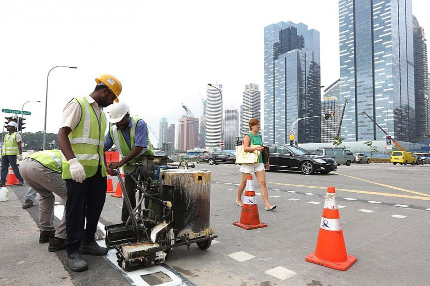 Road markings were being redrawn at Central Boulevard on Tuesday, Dec 31, 2013. -- ST PHOTO: ONG WEE JIN