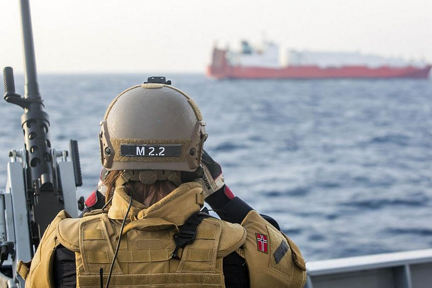 A Norwegian officer on deck on Dec 29, 2013, watching the cargo vessel Taiko, earmarked to transport chemical agents from war torn Syria.Disarmament teams returned Scandinavian escort vessels to port on Monday, Dec 30, 2013, as they accepted an