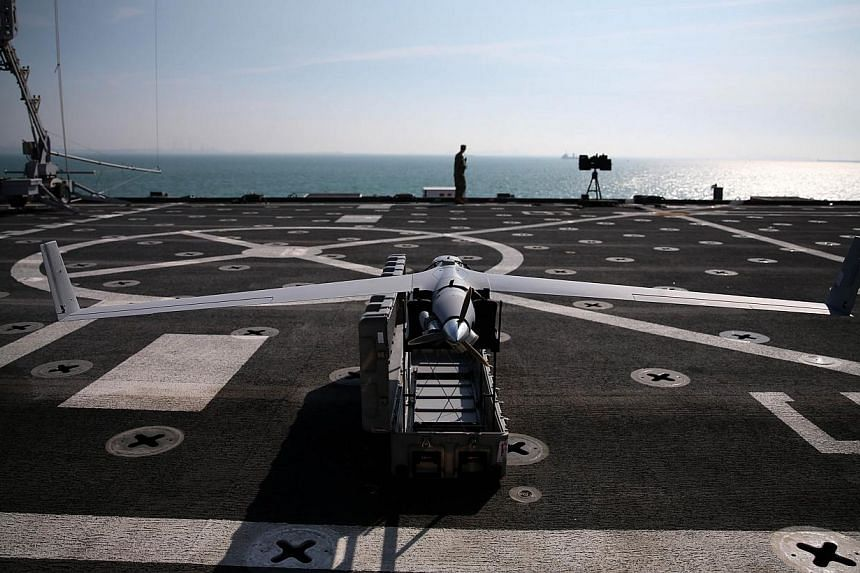 A Scan Eagle drone sits on the deck of the USS Ponce, on Dec 6, 2013 in Manama, Bahrain. US aviation regulators on Monday, Dec 30, 2013, released the names of sites picked to test civilian drones whose slated 2015 debut over American skies has s