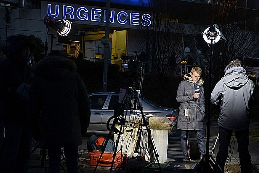 Journalists wait in front of the emergency services of the Centre Hospitalier Universitaire in Grenoble on Dec 30, 2013, where retired seven-time German Formula One world champion Michael Schumacher remains in critical condition after an off-piste sk