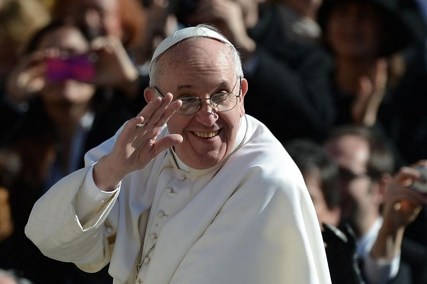 """Pope Francis waves to the crowd from the papamobile during his inauguration mass at St Peter's square on March 19, 2013 at the Vatican.The Vatican felt compelled on Tuesday to deny that Pope Francis had """"abolished sin"""", after a well-known Itali"""